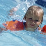 Young Girl Swimming with Water Wings ca. 2002